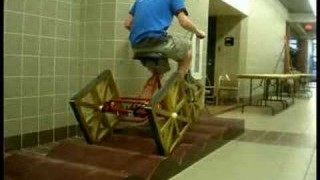 How do you ride a square-wheeled tricycle?