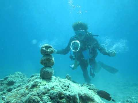 A diver makes underwater vortex rings that can knock over rocks
