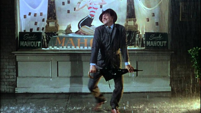 Gene Kelly performs Singin' in the Rain