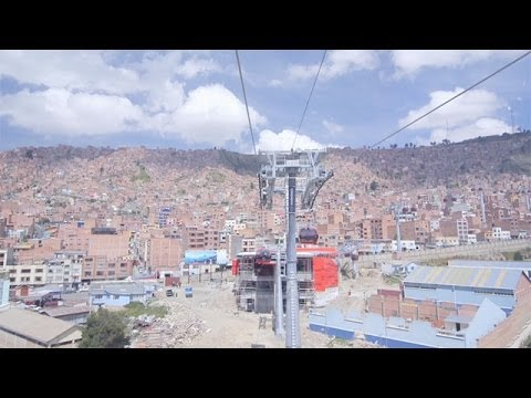 Ride the longest and highest urban cable car in the world.