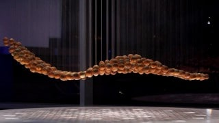 Breaking Wave: An anamorphic kinetic sculpture