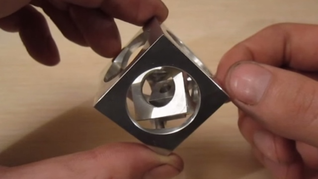 Machining a cube in a cube in a cube from a single metal block