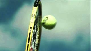 A racket flattens a tennis ball at 142 mph in slow motion