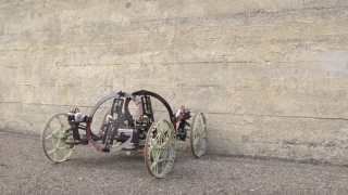 A robot vehicle that drives on walls using propellers