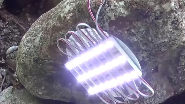 Plastic bottle water wheel power generator experiment