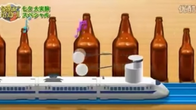A speeding toy train plays the William Tell Overture on bottles