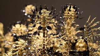 Bequeath These Seeds, a blooming brass wire kinetic sculpture