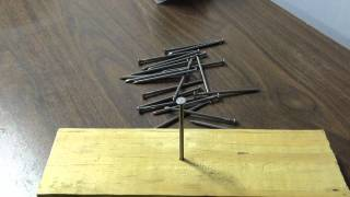 How many nails can you balance on the head of one nail?