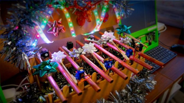 This festive robotic glockenspiel plays Christmas songs on demand