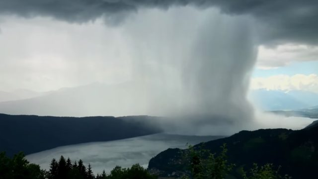 A microburst drops heavy rain over Austria's Lake Millstatt, a time lapse