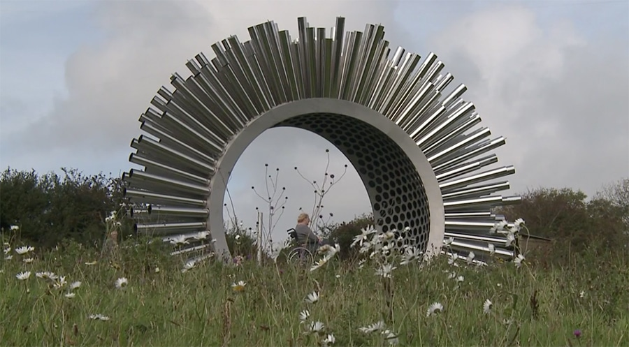 aeolus wind sculpture in a field