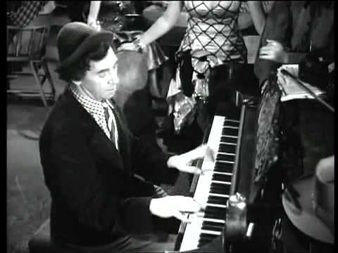 Chico Marx plays the piano (and an apple)