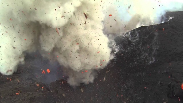Flying over Yasur Volcano as it erupts