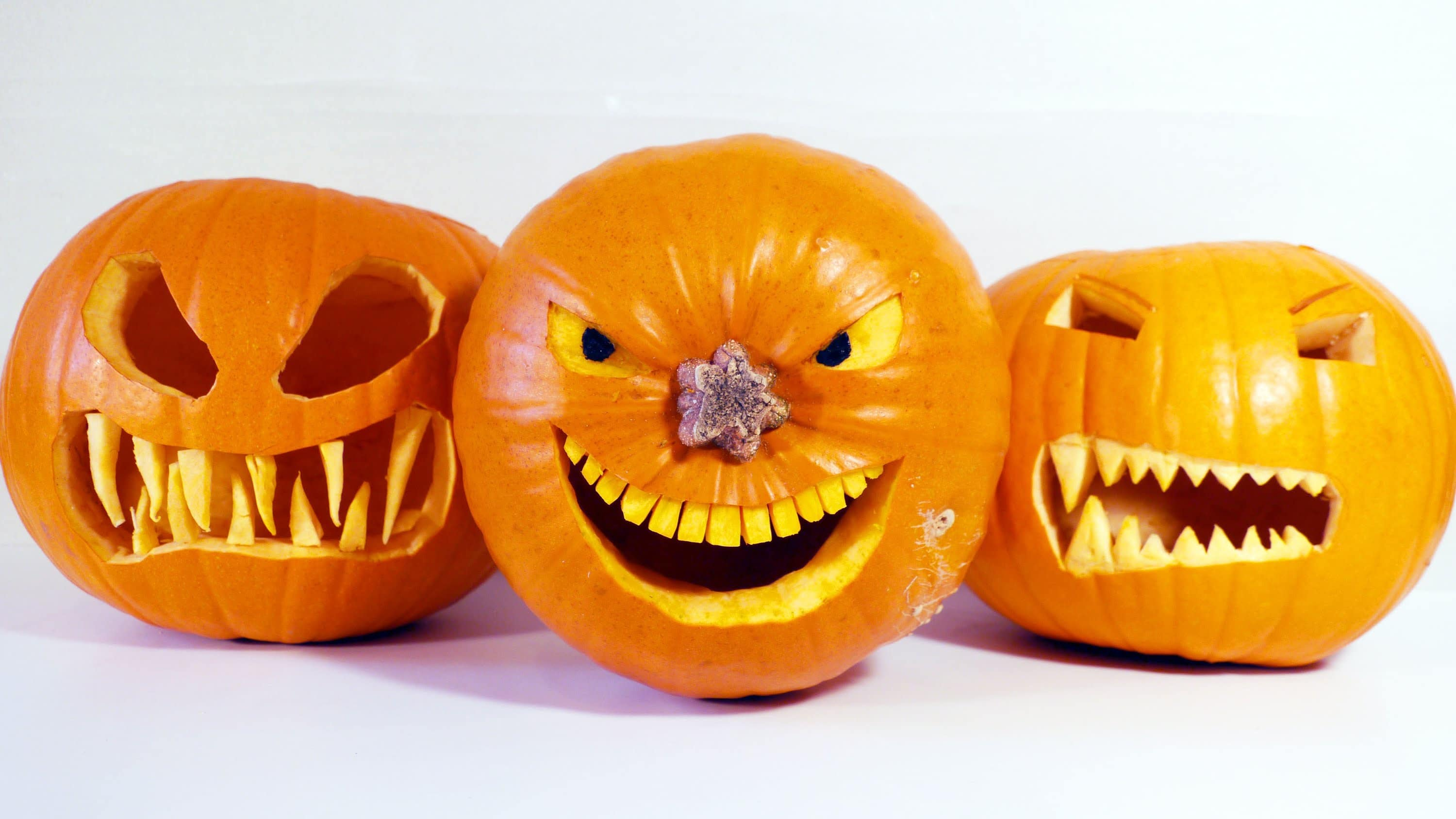 carving jack-o-lanterns with scary teeth