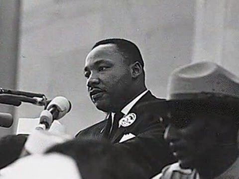 Dr. Martin Luther King, junior at the podium