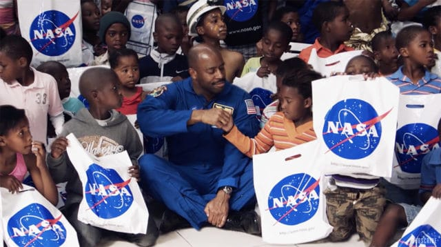 Leland Melvin with school kids