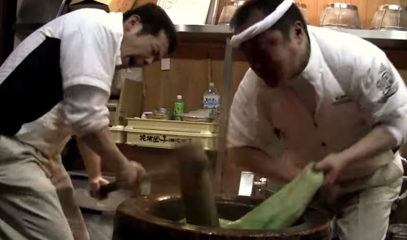 pounding traditional mochi