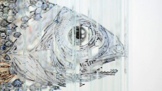 Four anamorphic paintings on a sculpture of glass: emulsifier