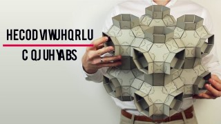 An origami-inspired model for reconfigurable materials