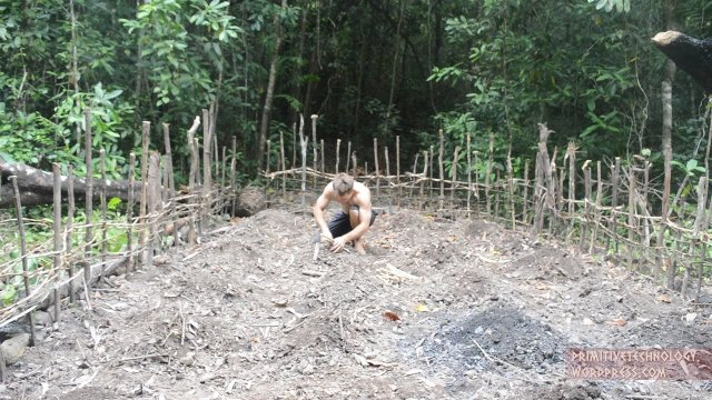 Demolishing an old hut to plant cassava and yams