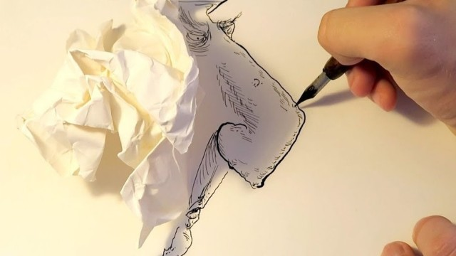 Drawing faces with the shadows of crumpled paper