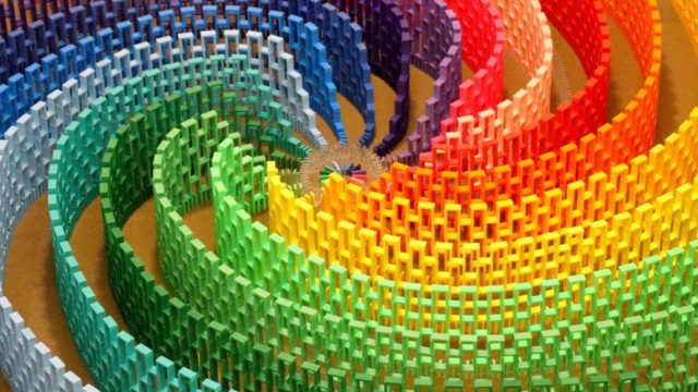 A 15-color rainbow spiral made with 12,000 dominoes