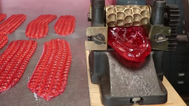 Making strawberry hard candy drops on a restored machine from Alaska, circa 1890