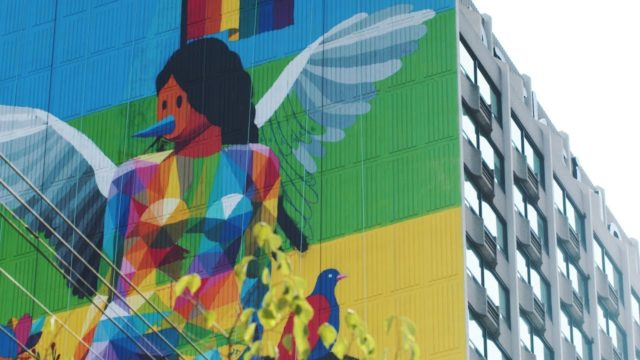 Okuda San Miguel paints a colorful 23-story mural in Toronto