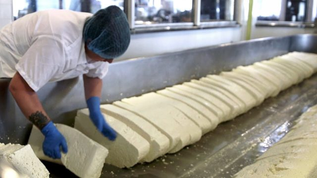 How is cheese made by hand?