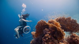 A dreamlike swim in an underwater wheelchair: Sue Austin's 'Creating the Spectacle'