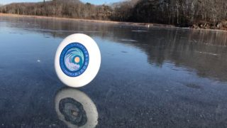 Rolling frisbee on a frozen lake