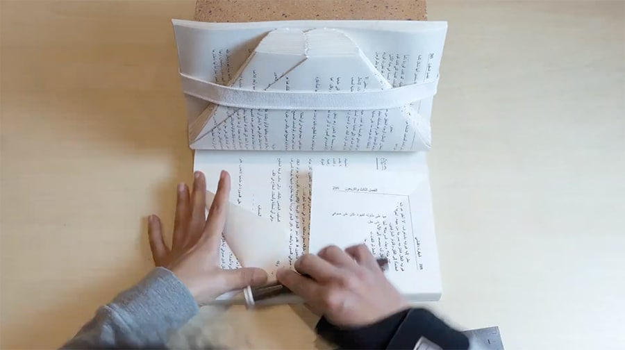 dina amin - folding the talking book pages