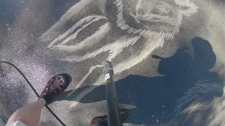 sketching a wolf with a power washer