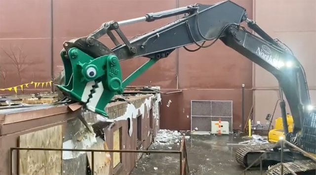 demolition dinosaur with googly eyes
