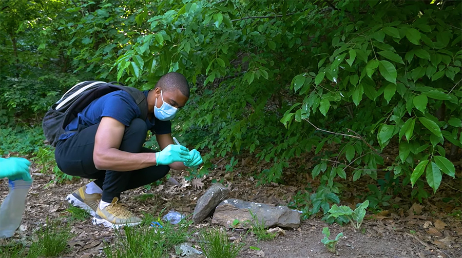 A Gonzalez brother taking samples in a local park